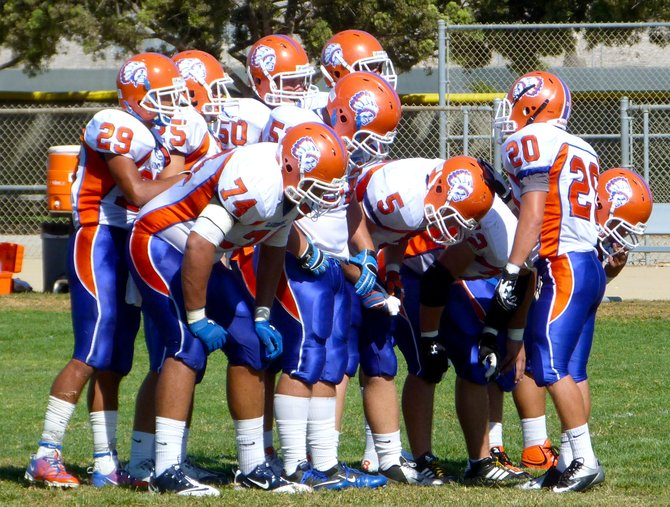 Clairemont linebacker No. 20 calls out the play in the defensive huddle