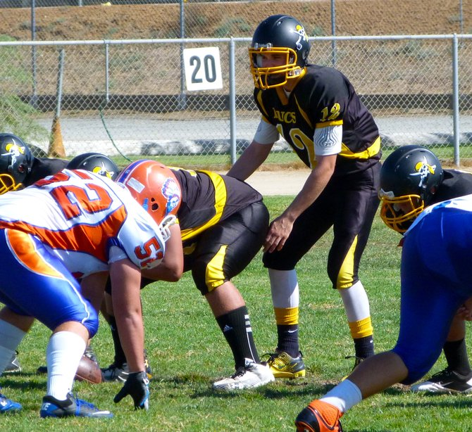 Mission Bay junior quarterback Nick Plum gets under center