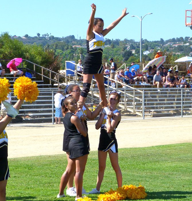 Mission Bay cheerleaders celebrate a Buccaneers touchdown against Clairemont