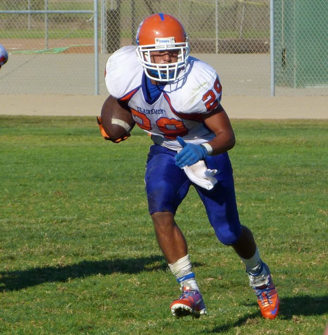 Clairemont senior running back Nick Espinoza runs the ball with room