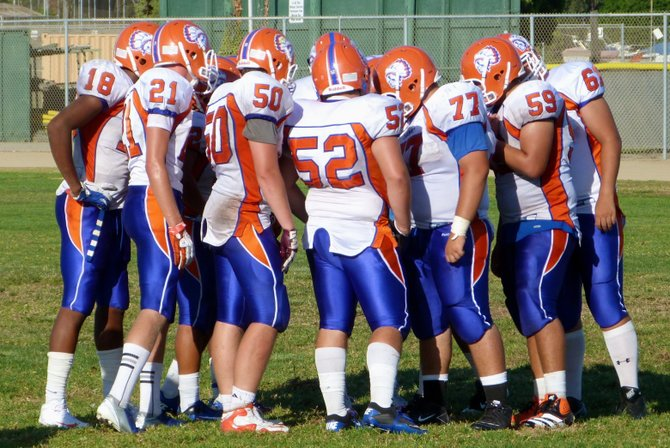 Clairemont in the offensive huddle