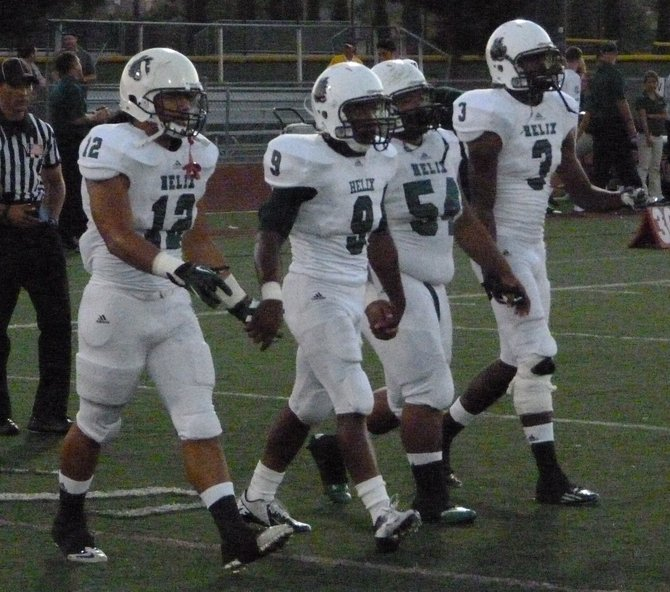 Helix team captains walk to midfield for the coin toss