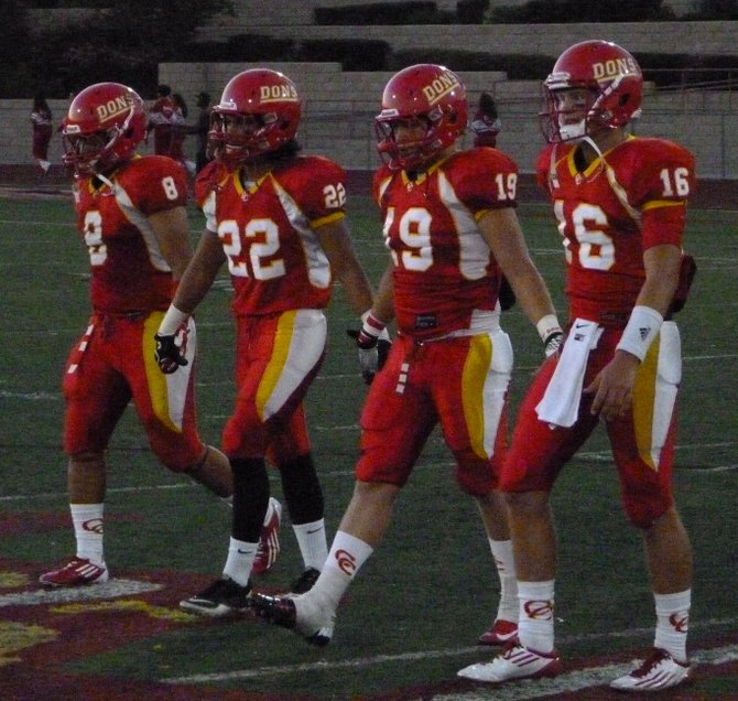 Cathedral Catholic team captains walk to midfield before the coin toss