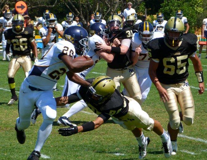 Army-Navy junior defensive back Leelye Kebede flies in to tackle Webb freshman running back Cameron Daugherty