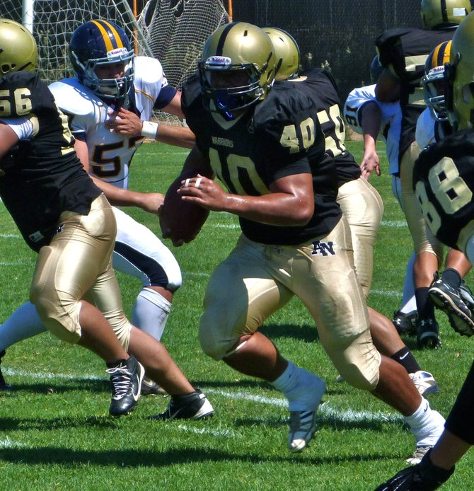 Army-Navy senior running back Joe Naotaola rumbles with the ball through space