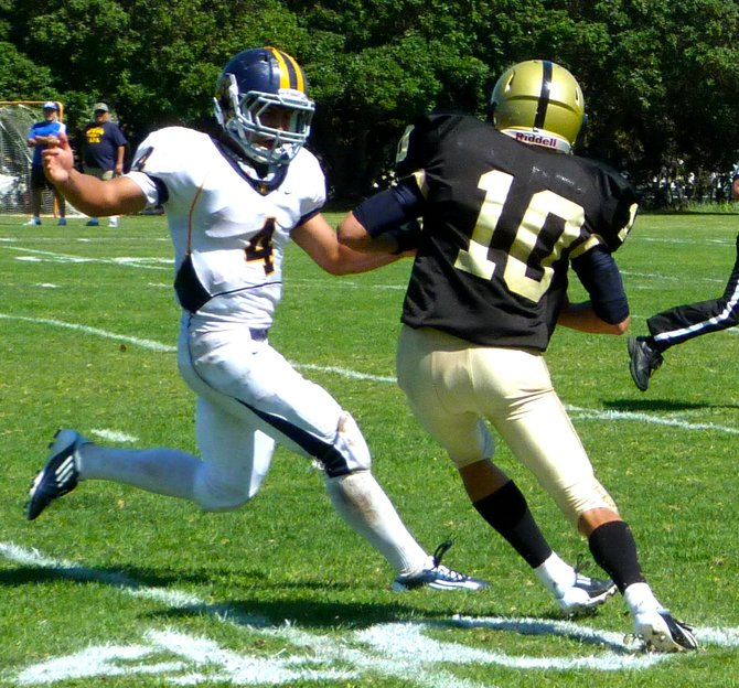 Army-Navy senior receiver Sam Harlib cuts inside of Webb senior safety Jordan Veiga after hauling in a pass