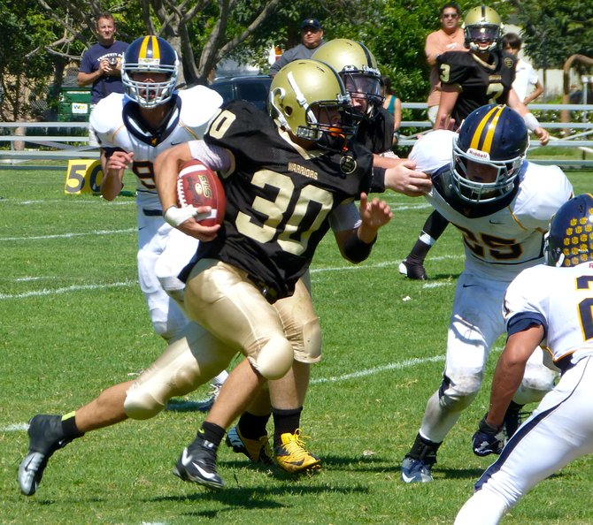 Army-Navy running back Mike Luque keeps his eyes downfield while carrying the ball