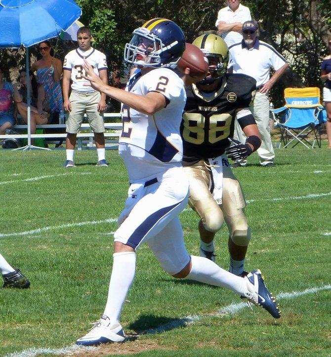 Webb senior quarterback TJ Fenton fires a pass with Army-Navy junior linebacker Kava Aviu closing in on the rush