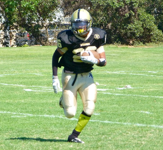 Army-Navy sophomore running back Tim Mack runs upfield on a kickoff return