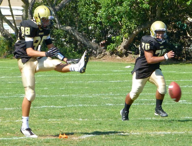 Army-Navy junior kicker Kava Aviu boots a line drive kickoff