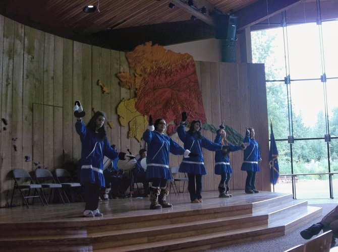 Native Alaskans perform traditional dances at the Alaska Native Heritage Center