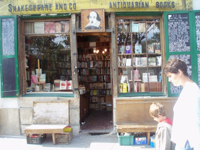 Mother and son approach Shakespeare & Co., the leading English language bookstore in Paris