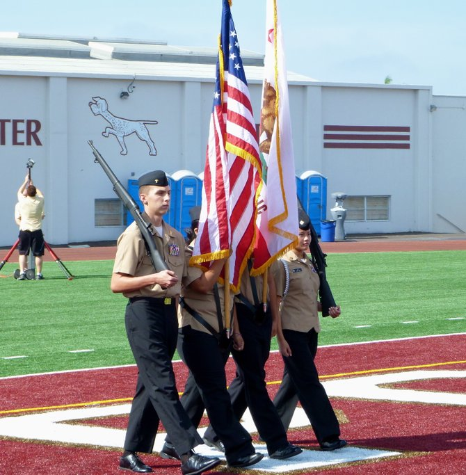 Members of Point Loma's Naval Junior ROTC program present the American flag for the national anthem