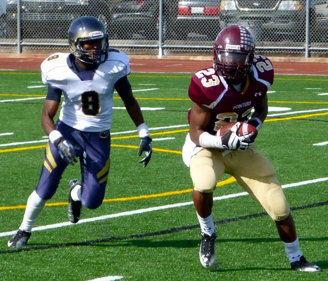Point Loma senior running back Jamal Agnew hauls in a pass in front of Morse junior defensive back Justin Hutsona