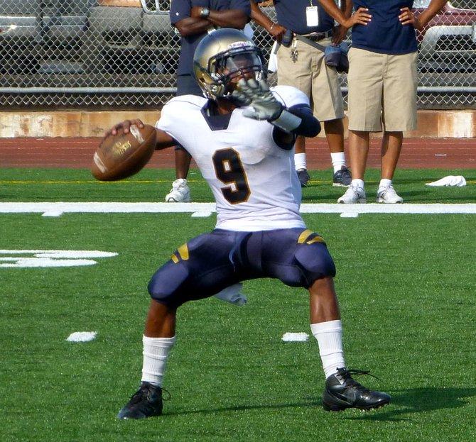 Morse senior quarterback Jamal Anderson fires a pass