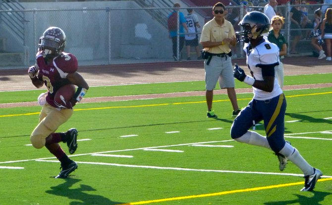 Point Loma junior running back D.J. Lacy heads into the end zone with Morse junior defensive back Justin Hutsona unable to catch him