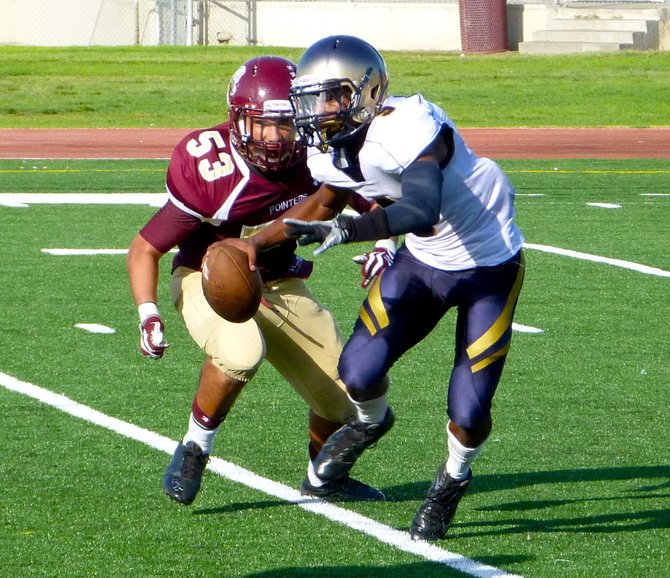 Morse senior quarterback Jamal Anderson tries to break away from the pressure of Point Loma senior linebacker Greg Verdugo