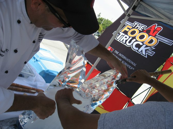 Chef Instructor at The International Culinary School at The Art Institute of California – San Diego Rudy Kloebe demonstrates how to carve ice during The Art Institutes Food Truck Tour festivities in Mission Valley, Saturday, Sept. 22.