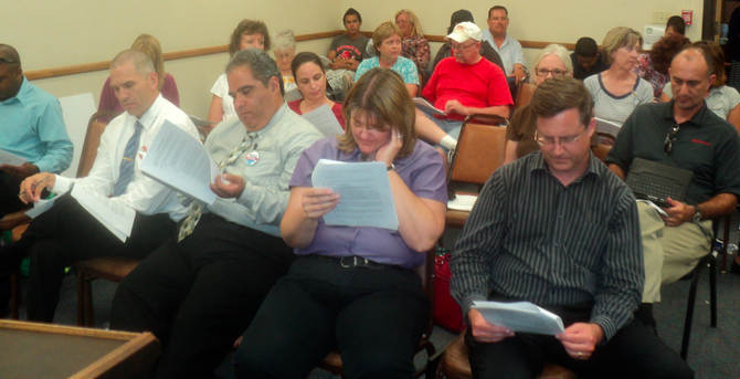 The audience, dazed by the time and the generous contract, was given 20 minutes to review the document.
