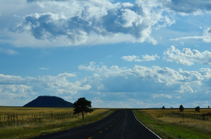 Driving through the back roads of Wagon Mound, NM (this is on the I-442 Southbound). I took this photo from the front windshield of my vehicle and it reminds me so much of a similar Desktop screensaver photo.
