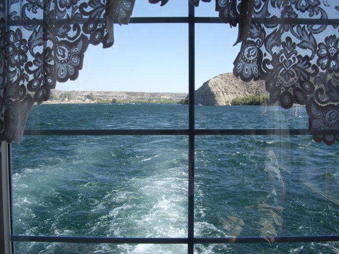 While on a small boat in Laughlin, NV. we watched the past pass us before our eyes.  My husband and I like to hit the casinos for a good time.  