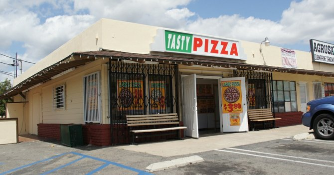 First victim was attacked in front of this pizza place.  Photo Weatherston