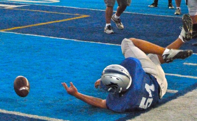 A West Hills player keeps the ball inbounds during a drill at Wolf Pack practice