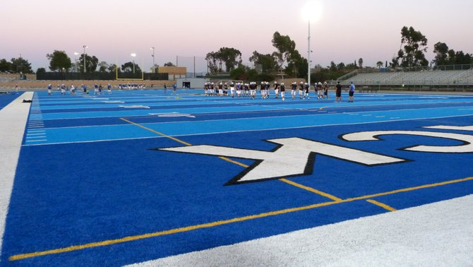 West Hills players practice on the blue turf