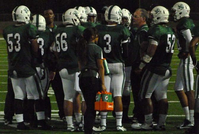Oceanside's defense talks things over during a break in the action