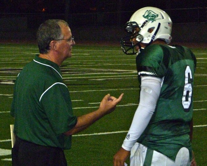 Oceanside head coach John Carroll gives the play to Pirates quarterback Tofi Paopao