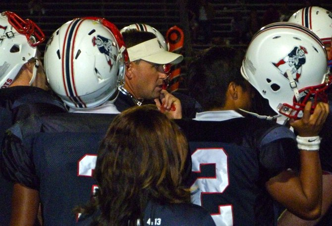 Christian huddles up around offensive coordinator David Beezer during a timeout