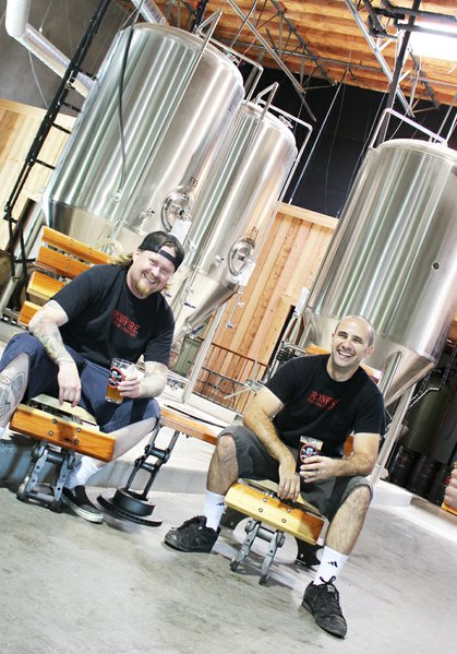 Greggory Webb (left) and John Maino share a laugh and a few cold ones in their new Temecula brewhouse.