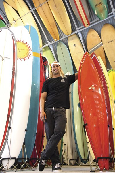 """Pro surfer Isaac Wood at Bird's Surf Shed. """"I had bosses that all surfed, and they would come back and be, like, 'Oh, you missed it. It was so good!'"""""""
