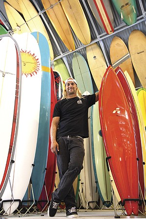 "Pro surfer Isaac Wood at Bird's Surf Shed. ""I had bosses that all surfed, and they would come back and be, like, 'Oh, you missed it. It was so good!'"""