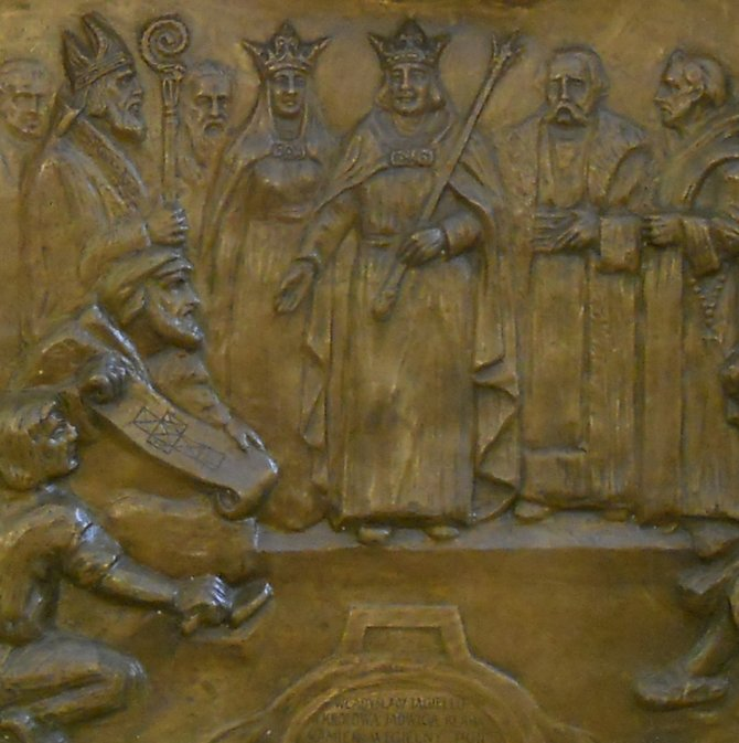 The St. Onuphrius Old Altar in the Corpus Christi Church in Poznan (Shooting Street). Four legends on the bronze plaques: 1. Bribed by Jews woman steals Holy Hosts from the Dominican Fathers' Church ('Przekupiona przez zydow niewiasta kradnie hostie sw. w kosciele O.O. Dominikanow'), 2. Jews stab the stolen hosts ('Zydzi kluja skradzione hostje'), 3. Bishop collects, along with the clergy, the stolen Holy Hosts in a meadow and carries Them in solemn procession to the city ('Biskup z duchowienstwem zbieraja hostje sw. na lace i odnosza je w uroczystem pochodzie do miasta'), and 4. Both King Ladislaus Jagiello and Queen Hedvig lay the foundation stone for the Corpus Christi Church ('Wladyslaw Jagiello i krolowa Jadwiga klada kamien wegielny pod kosciol Bozego Ciala', in the picture).