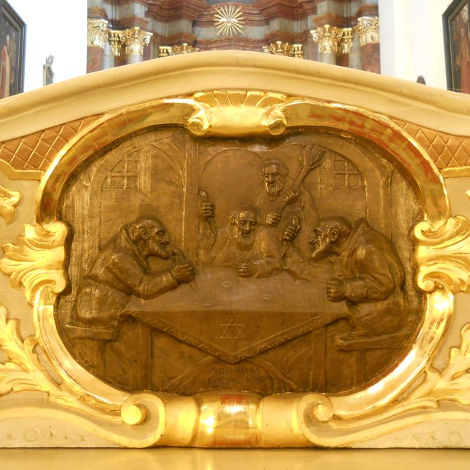 Jews Stab the Stolen Hosts ('Zydzi kluja skradzione hostje'). On the St. Onuphrius old altar in the Corpus Christi Church in Poznan, in the middle of the main nave, four bronze plaques present the history of the stolen Holy Eucharist by the Jews on 15 August 1399. One of them in the picture has a title legend. The then Bishop Adalbert Jastrzebiec moved the Body of Christ (stolen from the present Jesuit church, desecrated in the house on the Jewish Street, and abandoned on the Warta meadows in a place where the church was founded in 1406) to the St. Mary Magdalene Parish Church on Collegiate Square.