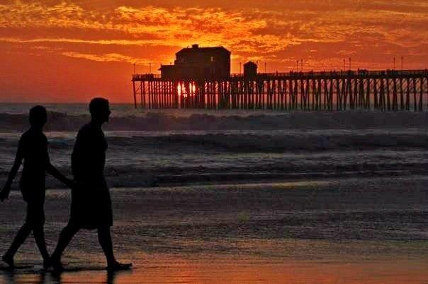 Oceanside pier as sun sets behind Ruby's Restaurant