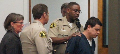 Christopher Nutt brought into court last May.  Photo Weatherston