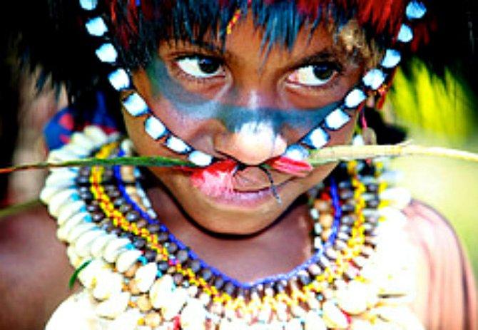 A Kontu child in tribal dress.