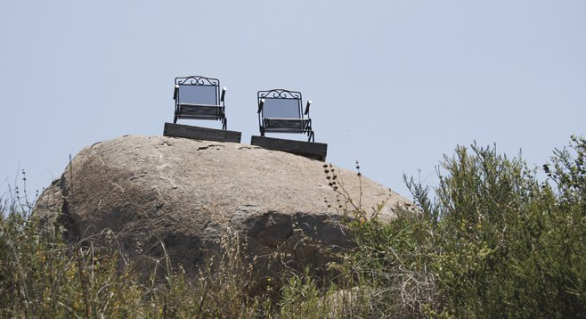 A thousand feet of elevation gain makes it a strenuous hike, but the panoramic view from these chairs is your reward.