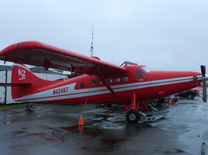 Float plane now outfitted with skis to land on the snow in Anchorage, Alaska.