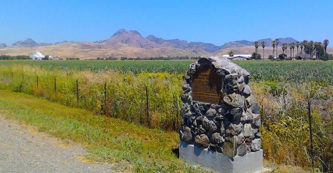 "Travel. The world's smallest mountain range: the Sutter Buttes, seen on vacation, at the southern side, just outside of Yuba City. The historical marker informs that this is ""THE SITE OF PROPAGATION OF THE THOMPSON SEEDLESS GRAPE."" Your green table grapes came from here."