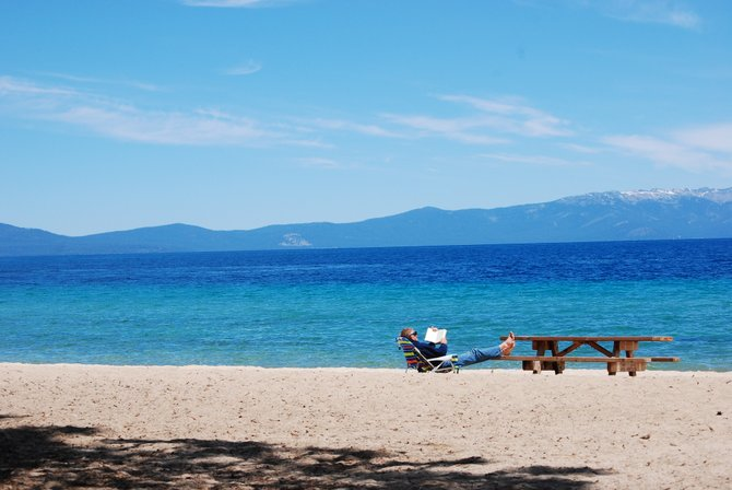 Relaxing on the shore by Lake Tahoe, the second-deepest lake in the USA.