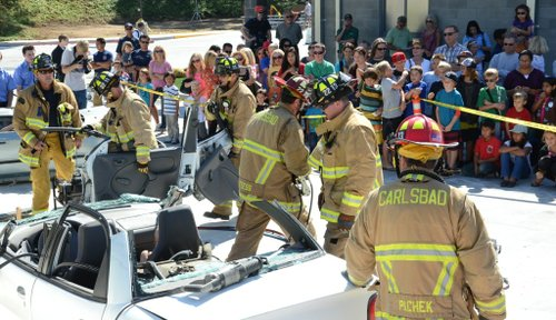 Firefighters swarmed a crushed car.  Photo Weatherston