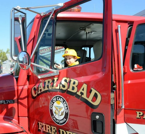 Kai Williams in a fire dept vehicle.  Photo Weatherston.