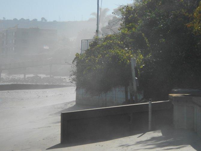 Fog snakes in along Kellogg's Beach in Pt. Loma.