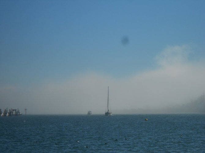 Heavy fog rolls in over the tip of Pt. Loma on 10/15/12.
