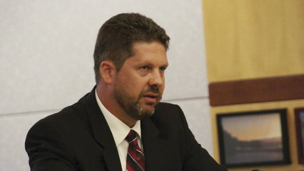 Defense attorney Andrew Limberg argued the crime down from assault on a police officer to negligent discharge of a firearm and other lesser charges.
