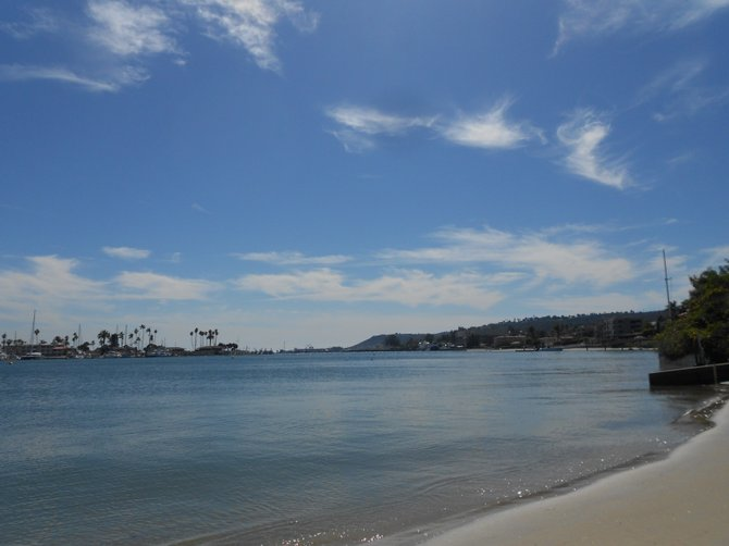 Playful high clouds dot the sky above San Diego Bay near Shelter Island.