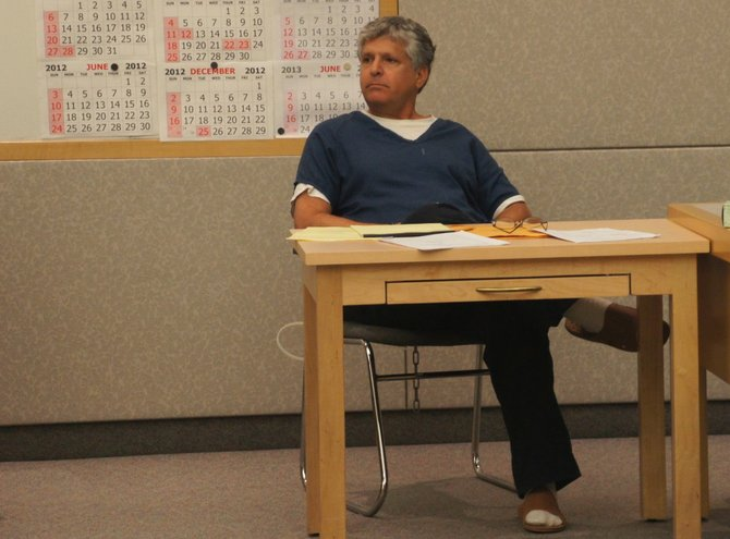 M.T. Pines in court last August, chained to his chair.  Photo Weatherston.